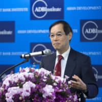 Naoyuki Yoshino, dean of the Asian Development Bank Institute, speaks during the organization's annual conference in Tokyo in 2016. | BLOOMBERG