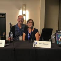 Storytellers: Anime localizers Les and Mary Claypool talk at a 'Ghost in a Shell' panel. | COURTESY OF LES CLAYPOOL