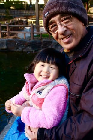 Bonding with the local wildlife: Kikutaro Toku, 73, and his granddaughter Die Kashima, 3, feed the ducks in Togoshi Park.