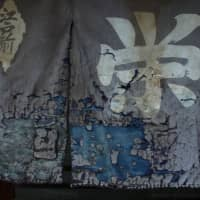 Shabby chic: A faded noren curtain hangs in front of a sushi restaurant in Togoshi, Tokyo. | KIT NAGAMURA
