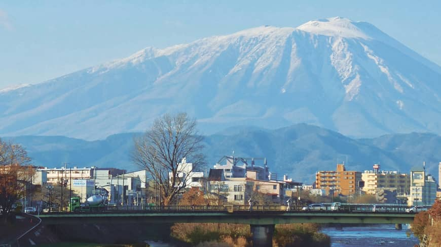 Bleak but beautiful: Mount Iwate dominates the skyline of the city of Morioka
