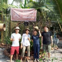 Farming ambitions: Yu Nakamura (second from right) and her husband (far right) with farmers at a coconut sugar plantation in Thailand.