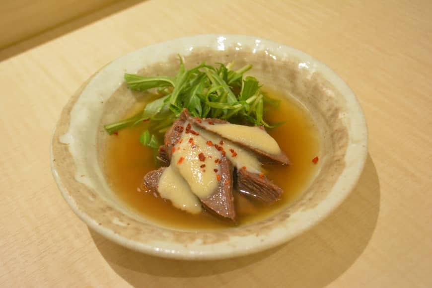New classic: Beef tongue with white miso and flecks of chili in a dashi soup.