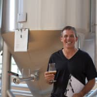 Not a beginner anymore: Bryan Baird poses in front of his brewing system.   JEREMY WILGUS