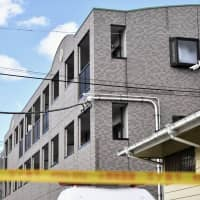 Family home: The exterior of an apartment block in Noda, Chiba Prefecture, that was home to a 10-year-old girl who allegedly died at the hands of her father | KYODO