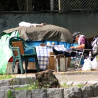 Displaced: A homeless man camps out in Ueno Park in northeastern Tokyo. | JAMES ABBOTT / CC BY-SA 2.0