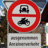 Sign language: A sign in Austria that features pictures of an old-timey car and motorbike includes the words 'ausgenommen Anrainerverkehr,' which in German effectively means 'no through traffic' or 'residents' vehicles only.' | AMY CHAVEZ