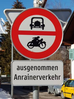 Sign language: A sign in Austria that features pictures of an old-timey car and motorbike includes the words