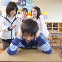 The kids aren't alright: Bullying continues to be a problem at Japanese schools, but the city of Otsu wants to introduce a new way to deal with it. | GETTY IMAGES