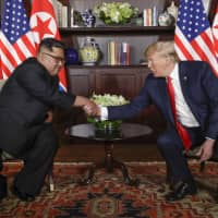 Shown here shaking hands at their first summit on June 12, 2018, U.S. President Donald Trump and North Korean leader Kim Jong Un will meet for a second time in Hanoi on Feb. 27 and 28. | AP