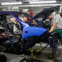 Employees build a Nissan Juke at the Nissan Motor Co. production plant in Sunderland, England. Nissan announced Monday that it was canceling plans to build its X-Trail SUV at the plant despite Brexit assurances from the government. | BLOOMBERG