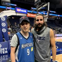 Caption: Hard-core basketball fan Mitsuaki Ono (left) befriended NBA guard Ricky Rubio years ago, who now plays for the Utah Jazz, during his annual excursions to the United States to watch the Minnesota Timberwolves. The Kawasaki native has been a T-Wolves season ticket-holder since 2003. | COURTESY OF MITSUAKI ONO