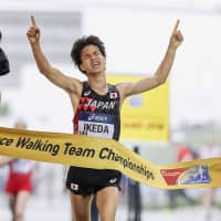 Koki Ikeda celebrates winning the men's 20-km race walk at the IAAF World Race Walking Team Championships on May 6, in Taicang, China. | GETTY/ VIA KYODO