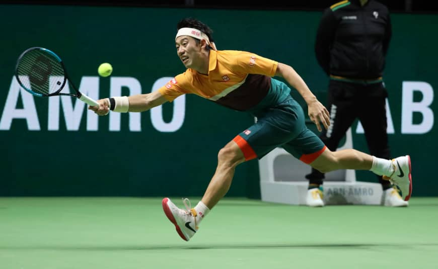Kei Nishikori hits a shot during his match against Stan Wawrinka at the Rotterdam Open on Saturday in Rotterdam, Netherlands. | REUTERS