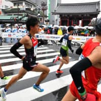 In pictures: The rain, the pain and the fun of Tokyo Marathon 2019