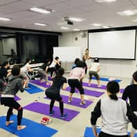 Rohto Pharmaceutical Co. employees participate in an exercise session. They can take part in such activities using Aruco in-house currency, which they earn based on their daily efforts and achievements toward improving their health. | ROHTO PHARMACEUTICAL CO.
