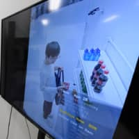 Tokyo-based startup Vaak demonstrates a crime prevention system that uses artificial intelligence to catch shoplifters. | BLOOMBERG