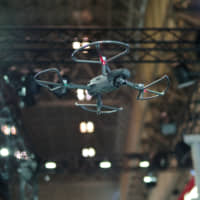 A drone hovers during a demonstration Wednesday at the Japan Drone 2019 exhibition at Makuhari Messe in Chiba Prefecture. | RYUSEI TAKAHASHI