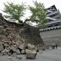 A collapsed stone wall at Kumamoto Castle is seen in May 2016, a month after two powerful earthquakes jolted central Kyushu. | KYODO