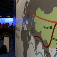 A map illustrating China's silk road economic belt and the 21st century maritime silk road, or the 'One Belt, One Road' megaproject, is displayed at the Asian Financial Forum in Hong Kong in 2016. | REUTERS