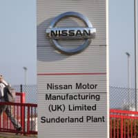 Workers leave the Nissan car plant after finishing their shift in Sunderland, northeast England, in 2016 Nissan will stop production of Infiniti cars at its factory in Sunderland, the Japanese carmaker said Tuesday, one month after canceling the plant's plans for the X-Trail SUV. | AFP-JIJI