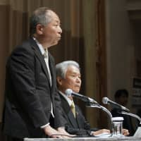Seiichiro Nishioka (left) and Sadayuki Sakakibara, co-chairs of a committee tasked with improving governance at Nissan, give a news conference in Yokohama on Wednesday. | AP