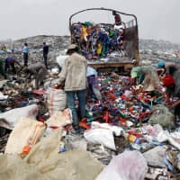 Scavengers sort recyclable plastic materials at the Dandora dumping site on the outskirts of Nairobi in 2017. | REUTERS