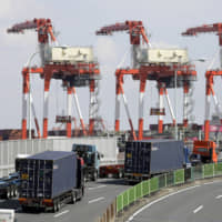 Japan's exports slump again on weak external demand, putting central bank on notice