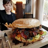 A giant wagyu burger, costing ¥100,000, is unveiled at a Tokyo hotel in honor of the upcoming ascension of Crown Prince Naruhito. | KYODO