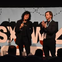 Akio Sakurai and film director Peter Michael Dowd appear in front of an audience for the world premiere of the documentary 'Mr. Jimmy' at the South by Southwest Film Festival. | KYODO