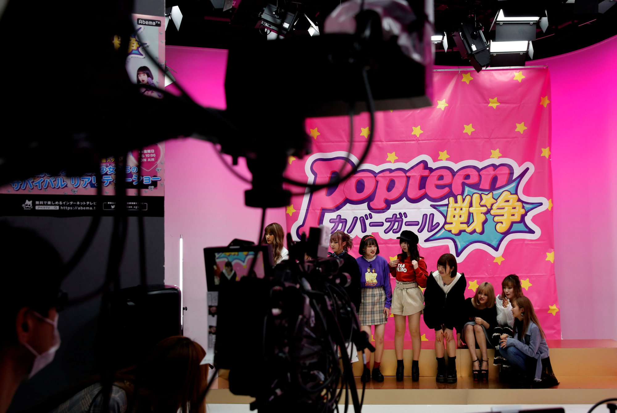 Pretty in pink: Popteen models prepare for filming at AbemaTV's studio in Tokyo. | REUTERS