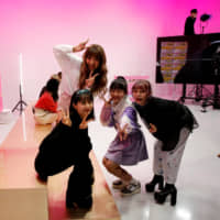 Take a break: Popteen models pose for a picture in between filming at AbemaTV's Tokyo studio. | REUTERS