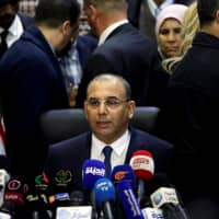 Abdelghani Zaalane, campaign manager of President Abdelaziz Bouteflika, speaks after he submitted Bouteflika's official election papers at the Constitutional Council in Algiers Sunday. | REUTERS