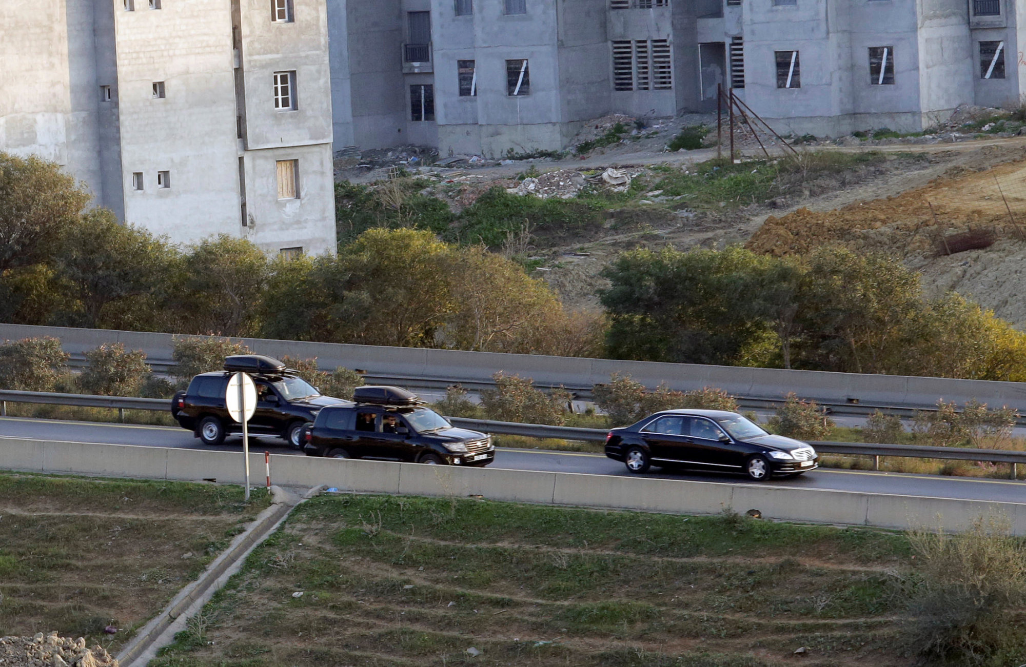 A convoy believed to be carrying Algerian President Abdelaziz Bouteflika is seen Sunday in Algiers. | REUTERS
