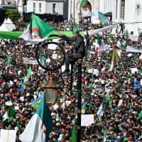 Hundreds of thousands march against Algerian leader Bouteflika