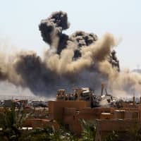 Battle for last Islamic State enclave edges toward end as U.S.-backed force combs for hidden fighters