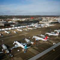 Boeing airplanes, many of which are grounded 737 MAX aircraft, sit at Boeing Field in Seattle Thursday. | REUTERS