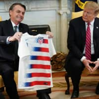Brazil's Bolsonaro backs Trump wall, derides U.S.-bound immigrants as bent on doing harm