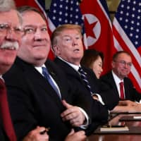 U.S. President Donald Trump (center), U.S. Secretary of State Mike Pompeo (second, left), White House national security adviser John Bolton (left) and acting White House Chief of Staff Mick Mulvaney (right) attend the extended bilateral meeting in the Metropole hotel with North Korean leader Kim Jong Un and his delegation during the second North Korea-U.S. summit in Hanoi Feb. 28. | REUTERS