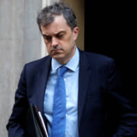 The U.K. Conservative Party's Chief Whip Julian Smith is seen on Downing Street in London on Monday. | REUTERS