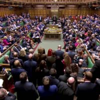 MPs listen as John Bercow, speaker of the house, announces the results of the vote on alternative Brexit options in Parliament in London on Wednesday. | REUTERS TV VIA REUTERS