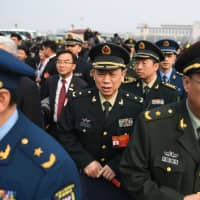 Military delegates arrive to attend the opening session of the Chinese People's Political Consultative Conference (CPPCC) at the Great Hall of the People in Beijing on Sunday. | AFP-JIJI