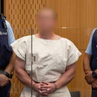 Brenton Tarrant, facing murder charges over Friday's Christchurch mosque attacks, is seen in the dock during his appearance in the Christchurch District Court on Saturday. | REUTERS