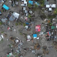 A general view shows destruction after Cyclone Idai in Beira, Mozambique, in this still image taken from a social media video on Tuesday.   CARE INTERNATIONAL / JOSH ESTEY / VIA REUTERS
