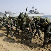 U.S. and South Korea kick off smaller-scale military drills as Trump blasts costs