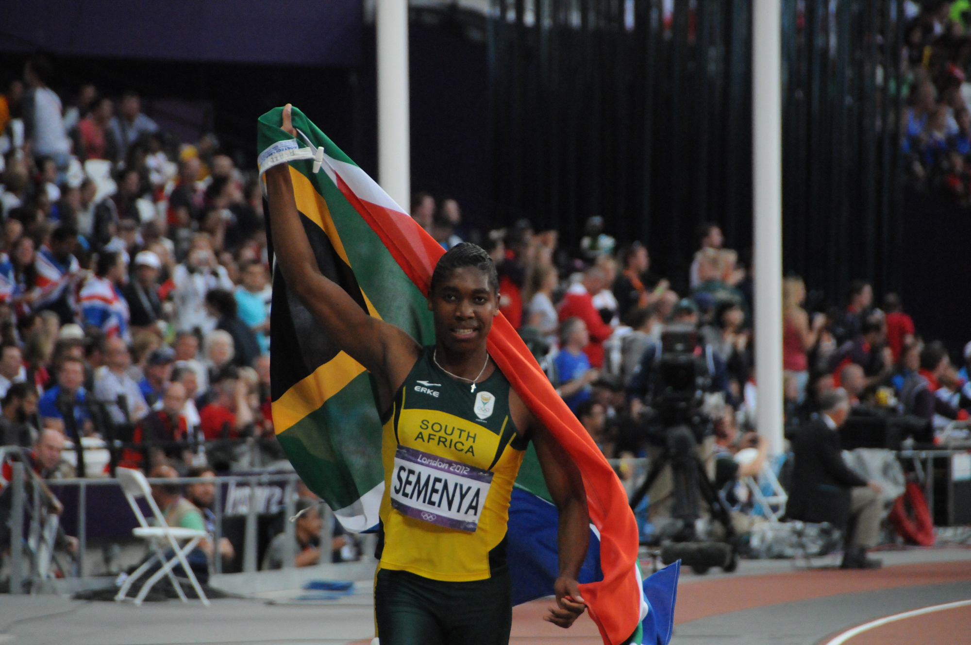 Caster Semenya holds the South African flag after winning the 800-meter gold medal in the 2012 London Olympics on Aug. 11, 2012.   TAB59, VIA WIKIMEDIA COMMONS / CC BY-SA 2.0