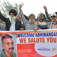 Indians shout slogans near the India-Pakistan border in Wagah on Saturday as they wait for the return of an Indian Air Force pilot being returned by Pakistan. | AFP-JIJI
