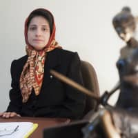 Iranian human rights lawyer Nasrin Sotoudeh, seen in her office in Tehran in this 2008 photo, was, according to her husband, handed a 38 year prison term and 148 lashes on Monday. | AP