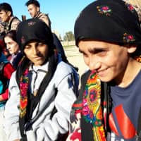 Wounded and alone, children emerge from last Islamic State enclave