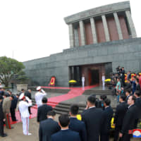 North Korean leader Kim Jong Un lays wreaths at the Ho Chi Minh Mausoleum in Hanoi on March 2.   REUTERS